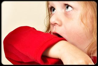 Pertussis-whooping-cough-s3-girl-coughing-into-sleeve